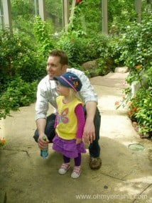 Omaha dad Aaron checks out the butterfly pavilion at Omaha's Henry Doorly Zoo & Aquarium.