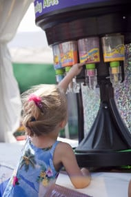 The spin/candy art booth is back at the Children's Fair! Photo courtesy Omaha Summer Arts Festival.