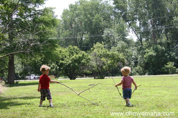 A favorite pasttime of my kids': Running with big sticks.