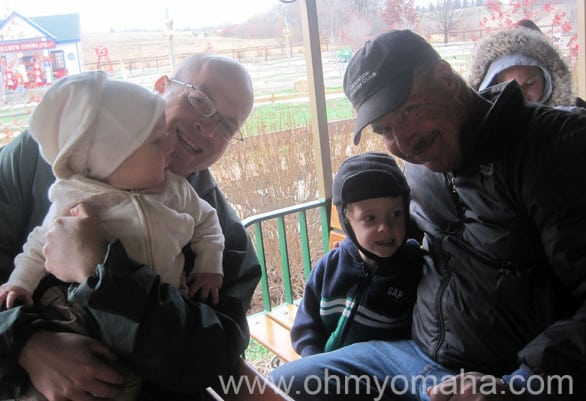 Mooch and Farley ride a freezing train ride with their dad and Grampy at Vala's Pumpkin Patch.