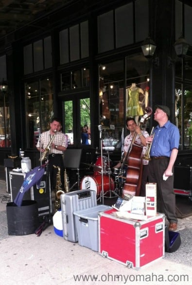 Kansas City-based band Grand Marquis plays on an Old Market street corner during a recent farmers market.