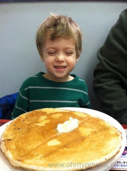 Farley is in heaven. A pancake bigger than his head, courtesy of Leo's Diner in Benson.