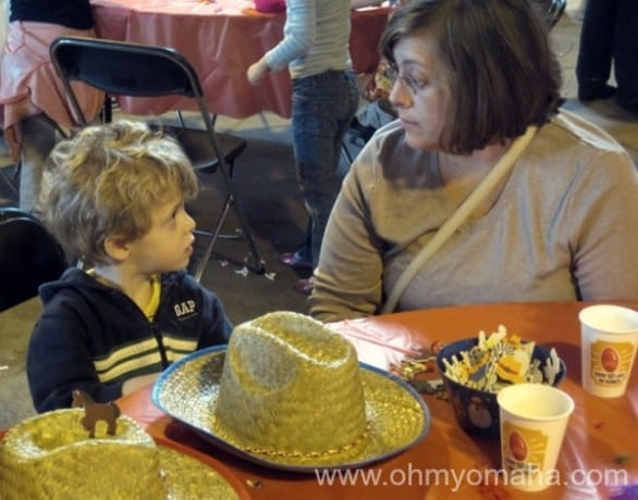 Decorating cowboy hats at the Omaha Police Mounted Patrol Barn in 2012. Farley is in a serious discussion with his aunt regarding the artistic direction of his hat.