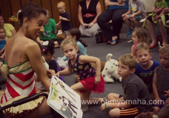 Karilyn reads to children during a Momaha story time in September.