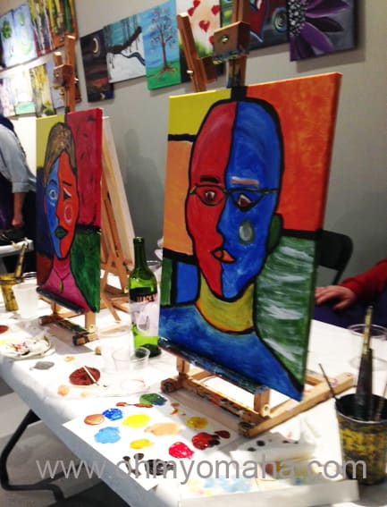 My husband's and my finished portraits from the couples painting class at Village Canvas and Cabernet.