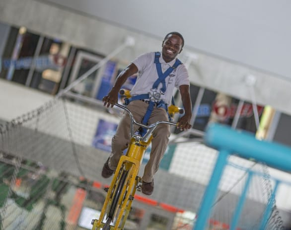 Yeah, you can can a bike on a cable 30 feet in the air at MOSI. Photo courtesy MOSI