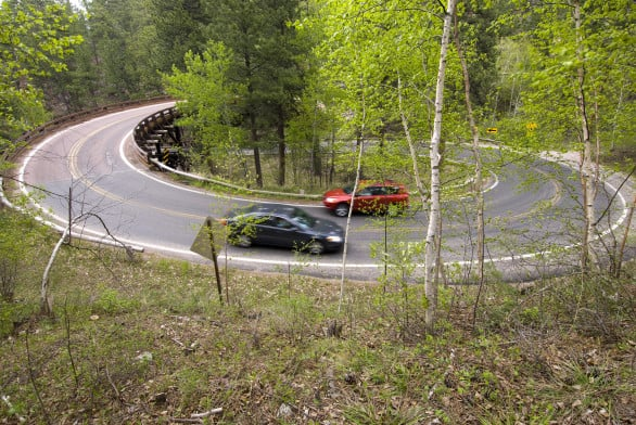 Cars on Iron Mountain Road, a famously curvy road near Mount Rushmore