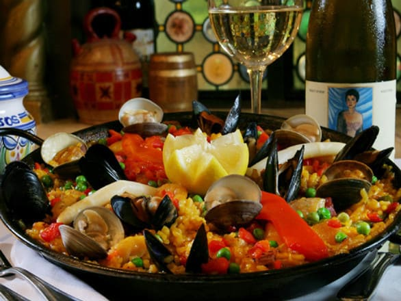 "One of The Columbia's signature dishes, Paella ""A la Valenciana."" Pair some sangria"