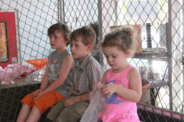 The kids eventually scooted up closer to the front of the bleachers to get a better view of the glass blowing.