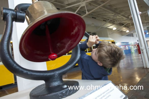 Things kids can do at The Durham Museum - Kids like to ring the bell on the bottom level of the museum.