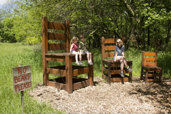 Over-sized chairs are found along the backwoods trail.