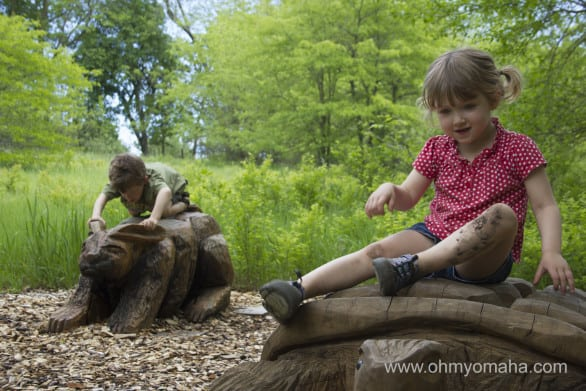 Happy and mud-covered children at Arbor Day Tree Adventure.