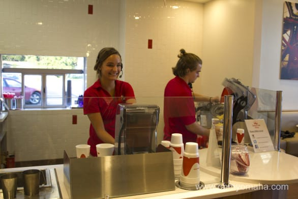 They're all smiles at the Smoothie King (note the drive thru window behind her).