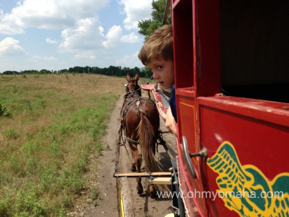 Boy looking out from a stagecoach at Fort Robinson State Park in western Nebraska.
