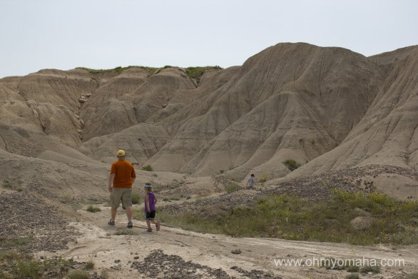 Family walking on a trail at Toadstool Geological Park in western Nebraska