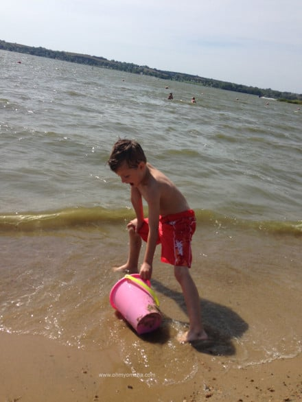 Boy playing in the sand at Branched Oak State Recreation area in Raymond, Nebraska.