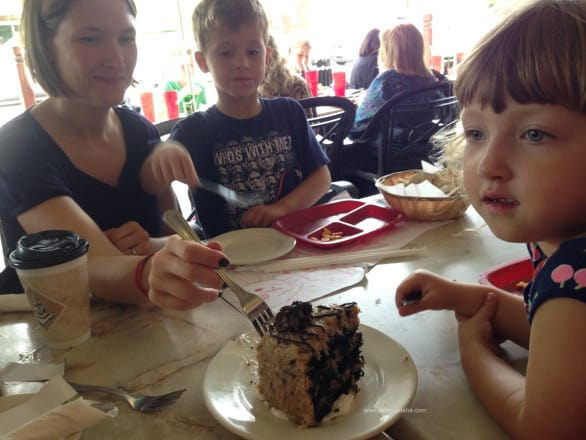 A family of four attempts to finish the German chocolate cake at Hollerbach's (after a full lunch) and fails.