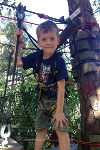 Farley conquering the kids' zip line course in Sanford, Florida.
