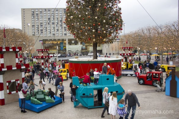 Play time at the base of the Mayor's Tree at Crown Center in Kansas City.