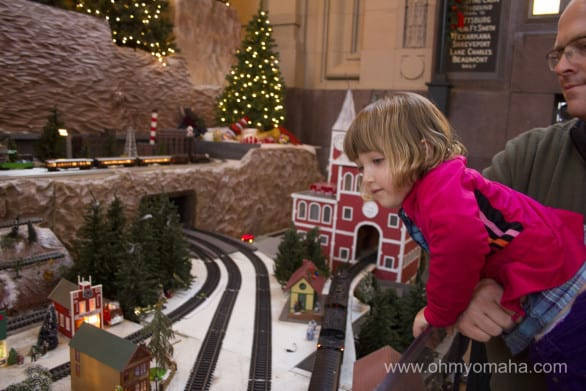 Trains of all sizes are at Union Station in Kansas City. There's even a mini train kids can ride, which travels through a Christmas-y scene.