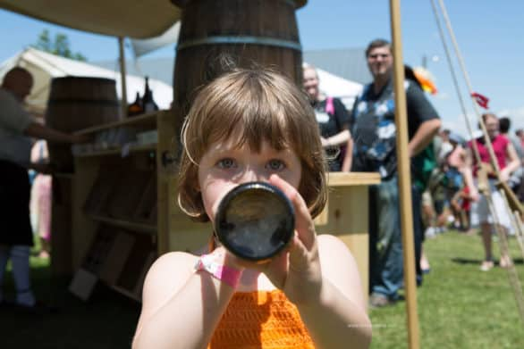 Mooch having a swig at the Iowa Renaissance Festival held at the park in Middle Amana. Relax. It's cream soda.