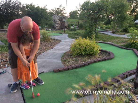 Mooch and Mr. Wonderful playing putt putt in Williamsburg at sunset.