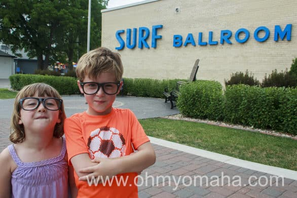 Kids with Buddy Holly glasses in front of the Surf Ballroom.