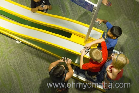 Kids race their LEGO cars on a test track at the Children's Learning Center.