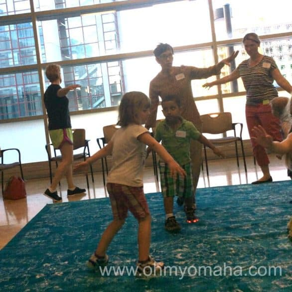 Since improvisation is a cornerstone of jazz, WeBop introduces in it to preschoolers in a fun way - like making sounds and pretending to be an airplane. My son took this picture - you can see me in the background with very weak wings.
