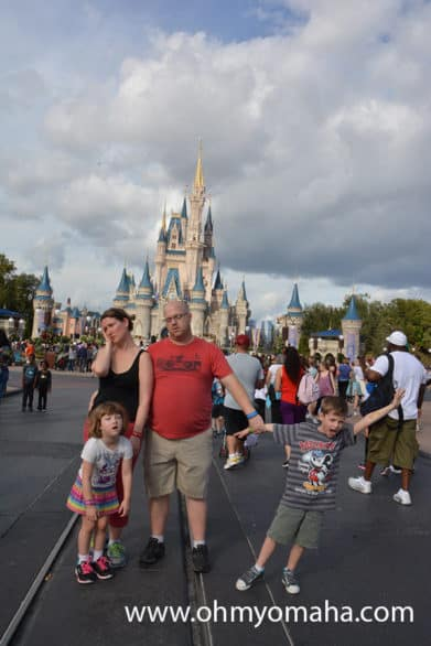 Funny family photo in front of Disney World castle