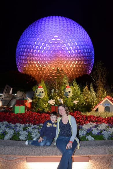 Photo in front of iconic Spaceship Earth at Epcot at Christmas time