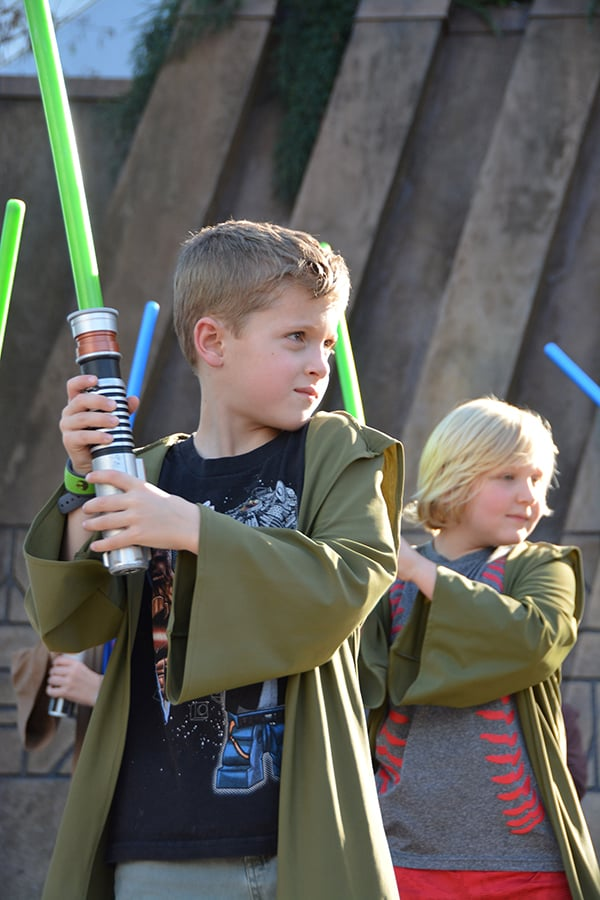 Boys holding light sabers during Jedi Training at Hollywood Studios