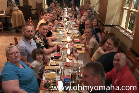 Nine families dining together at a restaurant at Coronado Springs Resort in Florida