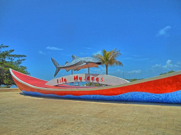 Bucket list of things to do on Isla Mujeres - Swim with a whale shark. The island is so well known for the whale shark, the island welcome sign has one on it.
