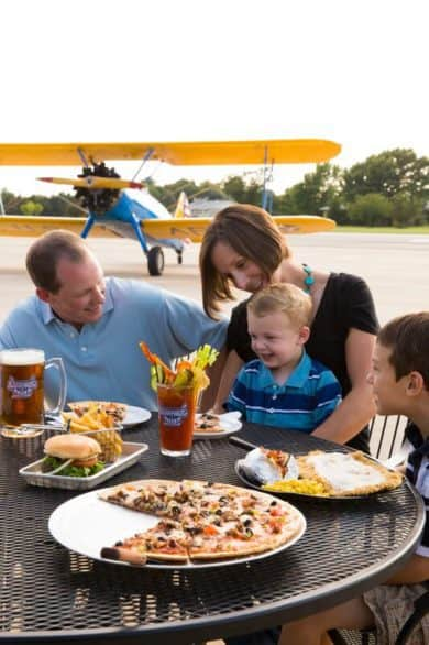 Outdoor table at Stearman Field Bar & Grill near Wichita, Kansas. It's a restaurant at an airfield.