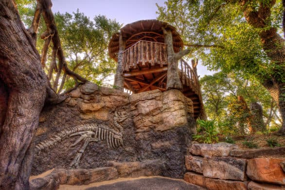 Fossil wall and little tree house in the Children's Garden at Botanica Wichita, the botanical gardens in the city