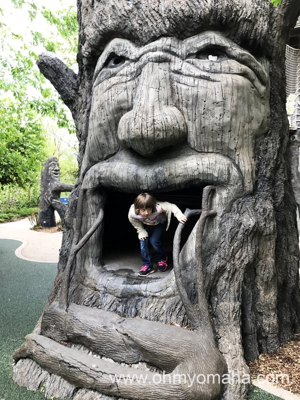 Playing around inside a monster tree sculpture at Botanica Wichita