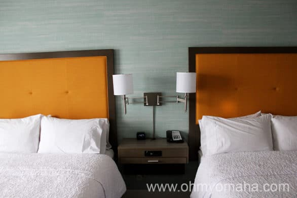 Room with two queen beds at  Hampton Inn & Suites Airport in Wichita, Kansas