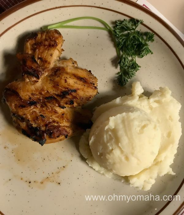 A plate of chicken and mashed potatoes at Johnny's Steakhouse