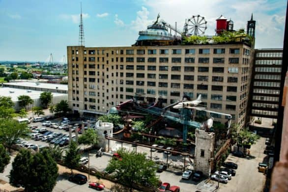 Exterior photo of The City Museum in St. Louis, with a view of the Ferris wheel on the roof