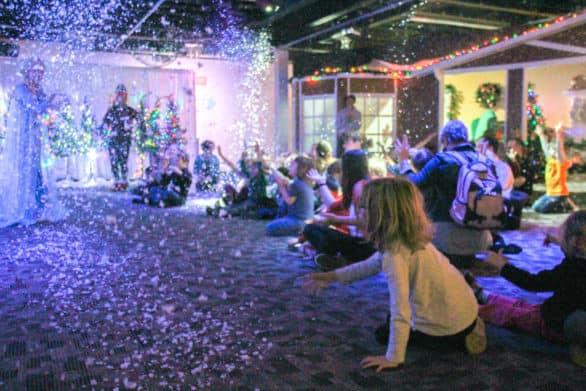 Indoor snowfall during Santa's Magic at Omaha Children's Museum