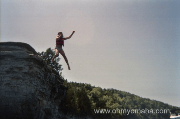Jumping off a small cliff into Table Rock Lake in Missouri