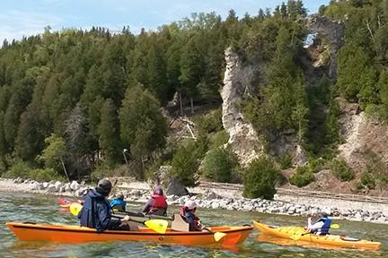 Kayaking near Arch Rock on Mackinac Island.