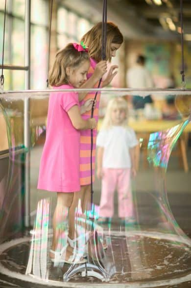 Standing inside a bubble at Grand Rapids Children's Museum