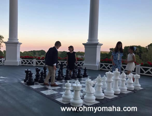 Oversized chess set on patio of Grand Hotel