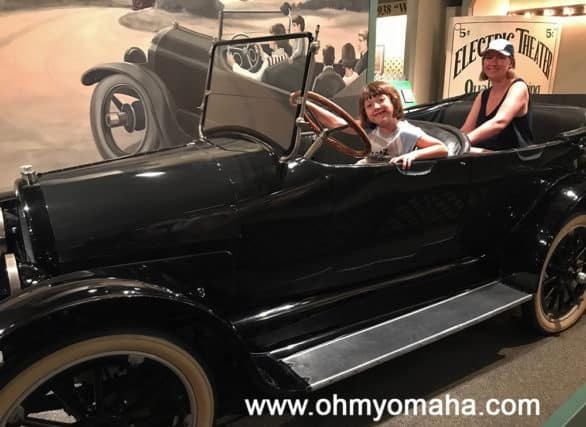 The Henry Ford is one of the top Detroit museums for families.  Who let my daughter behind the wheel of the 1917 Overland Car? There several photo opportunities throughout The Henry Ford, and we found them all.