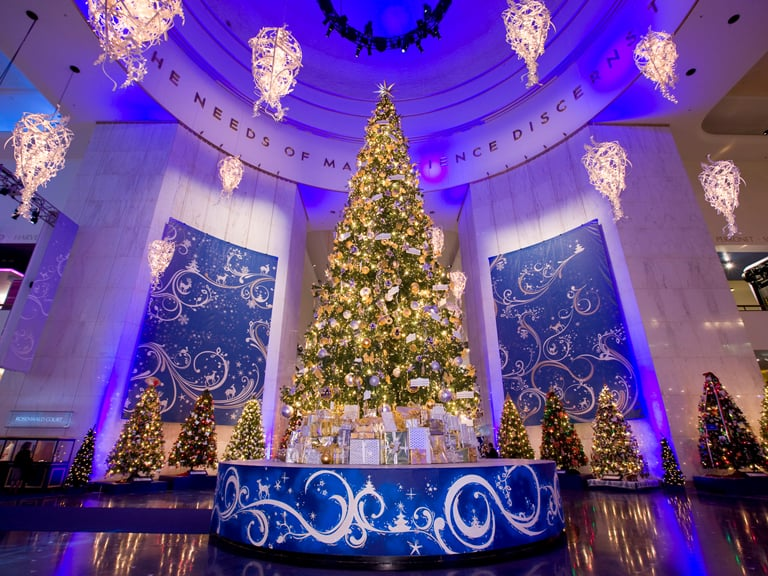 """Decorated trees at Museum of Science and Industry. The museum has an annual display called """"Christmas Around the World and Holidays of Light."""""""