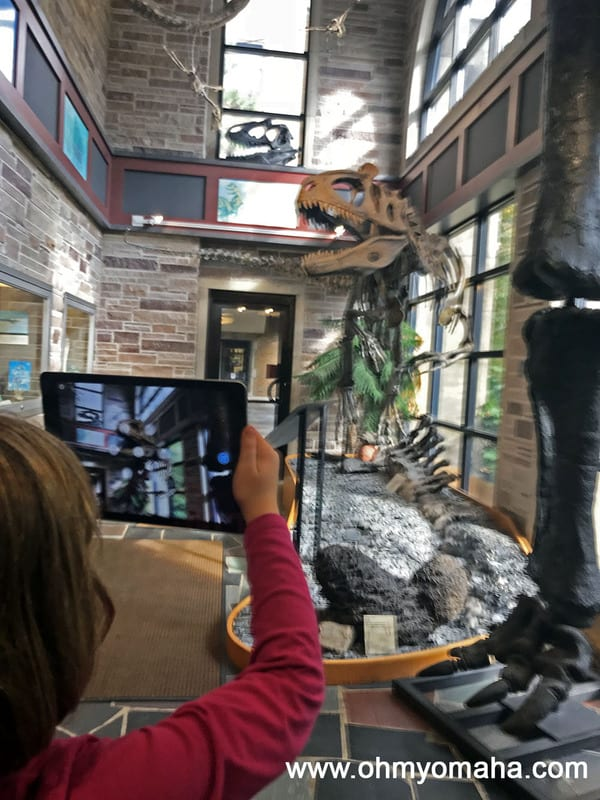 Viewing fossils with a special iPad app at Fryxell Geology Museum in Rock Island, Illinois