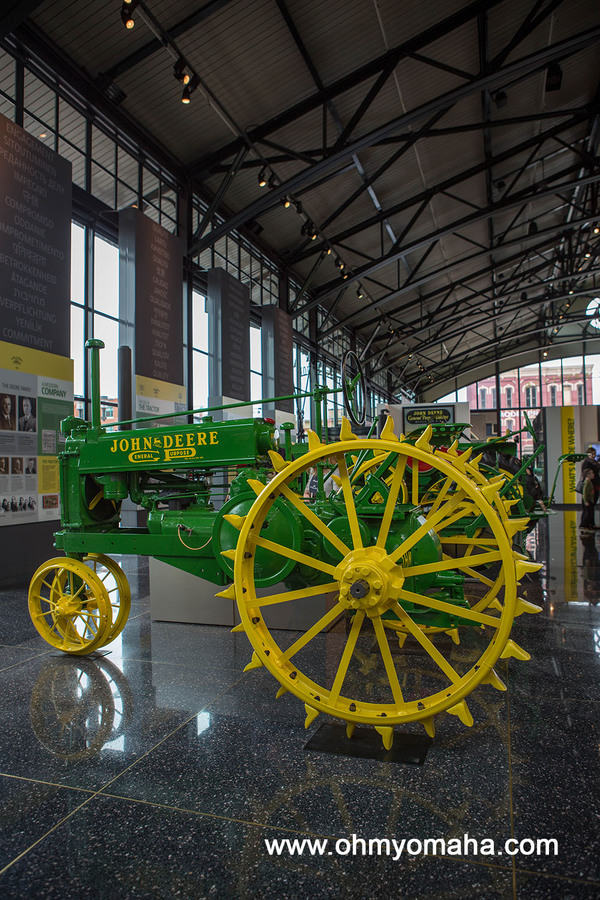 Antique farming equipment inside the John Deere Pavilion in Moline, Illinois