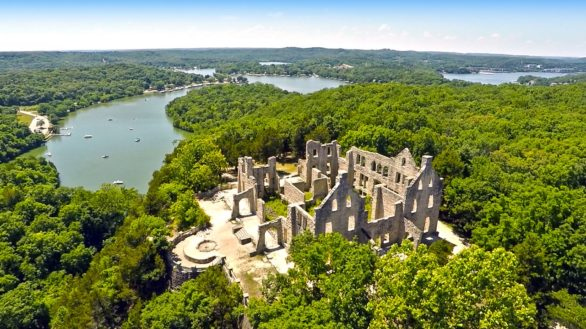 An overhead drone photo of the castle ruins at Ha Ha Tonka State Park in Missouri